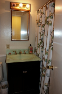Here's what our guest bathroom looked like before we updated the faucet, medicine cabinet, and lights